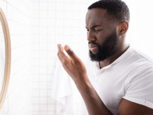 man with bad breath